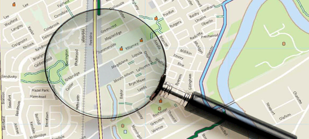 Image of a map with a magnifying glass