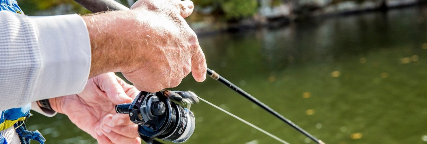 Image of hands reeling in a big fish