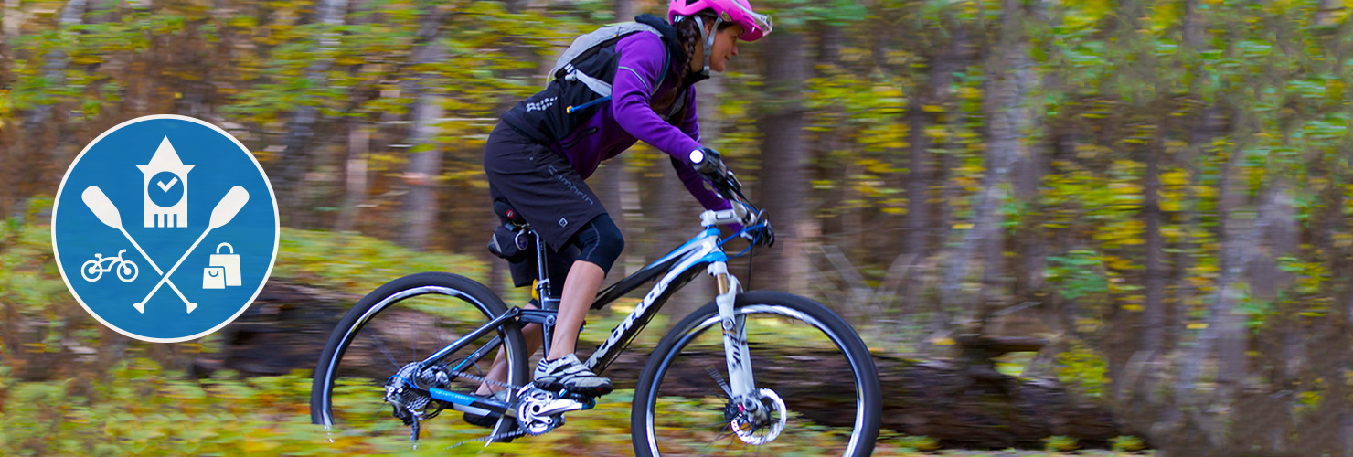 Girl riding trails on mountain bike