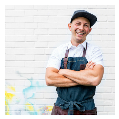 Image of Chef Matt Basile crossing his arms and smiling.