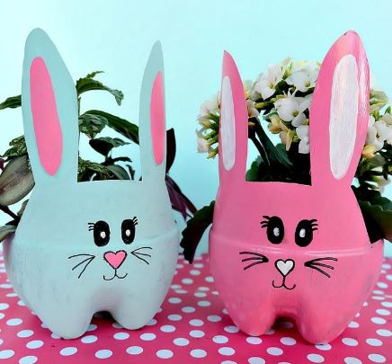 image of two plant holders that look like bunnies