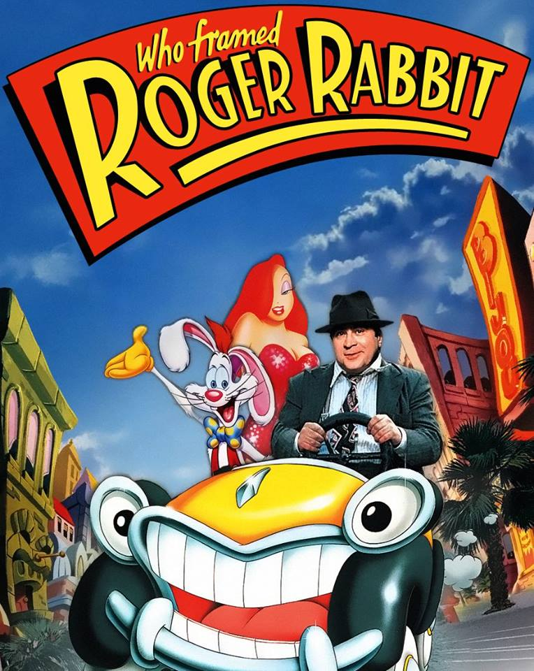 Image of cartoon rabbits and a man inside a cartoon car.