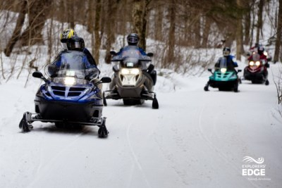 Image of Snomobilers on winter trails