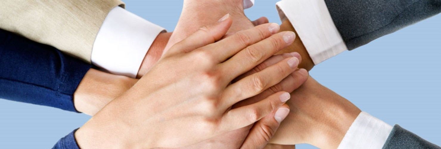 Image of hands in together as a team