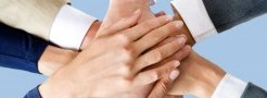 Image of hands in as a team