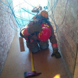 firefighter entangled in wires