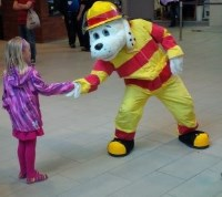 Sparky the fire dog says hello to a small girl